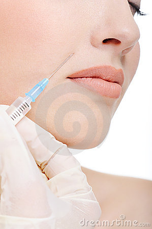 Botox shot on female cheek