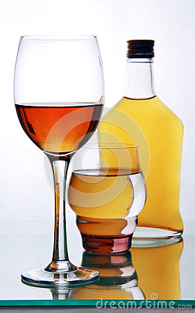 Free Bottle And Glasses With Alcohol. Royalty Free Stock Image - 35204006