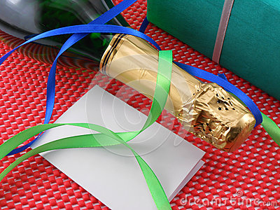 Bottle of a champagne and green gift boxes