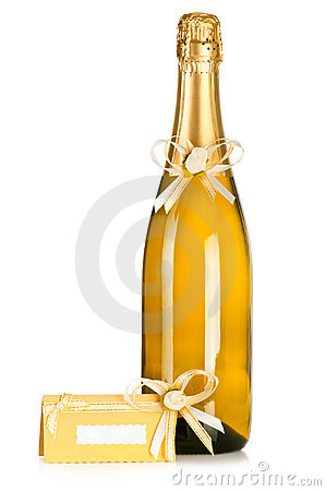 Bottle of champagne and wedding invitation card