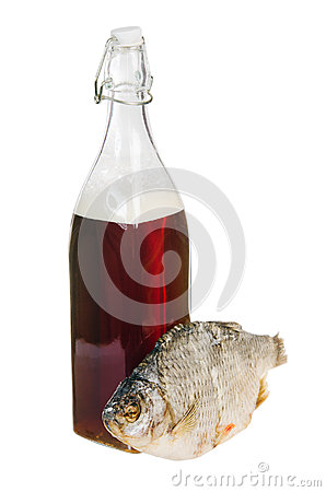 A bottle of domestic beer and dried fish
