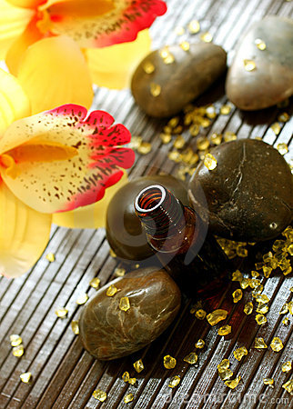 Bottle of essence oil, stones, bath salts and flow