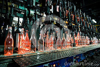 Bottle factory, row of glass bottles