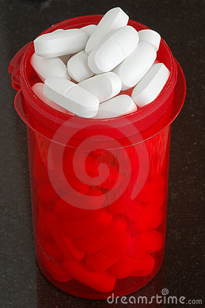 Bottle filled with calcium tablets