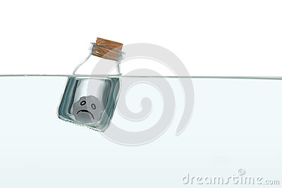 Sad face inside a bottle in water