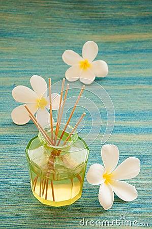 Bottle of fragrance reeds diffuser.