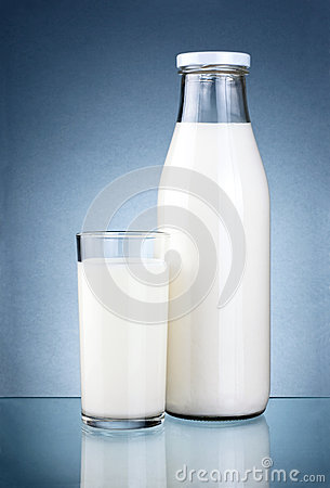 Bottle of fresh milk and a glass