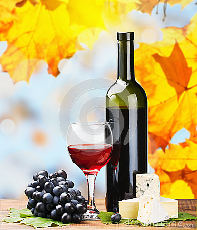 Free Bottle, Glass Of Red Wine And Assorted Cheeses Royalty Free Stock Photography - 26609317