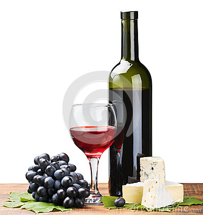 Bottle, glass of red wine and ripe grapes