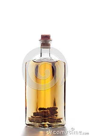 Bottle of homemade liquor isolated on white