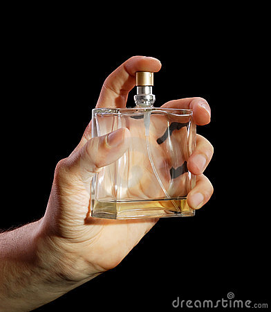 Free Bottle Of Cologne In A Hand At The Man Stock Photos - 8349383