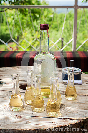 Free Bottle Of Plum Brandy With Small Glasses On Wooden Table Royalty Free Stock Photo - 81965945