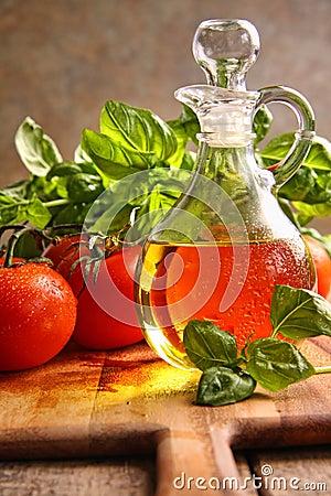 Bottle of olive oil with vegetables
