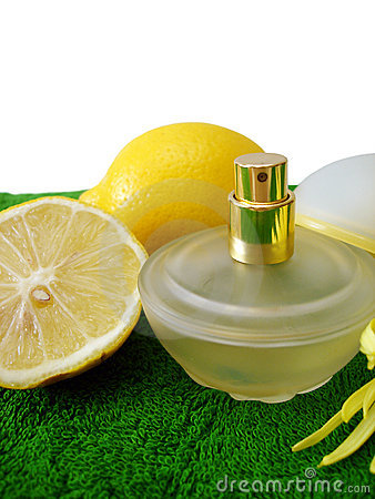 Bottle of perfume with lemon