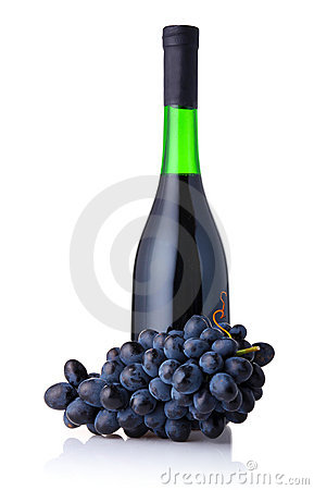 Bottle of red wine with bunch of grapes isolated