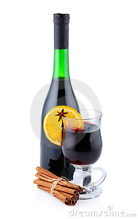 Bottle of red wine and cup of mulled wine isolated