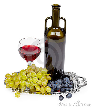 Bottle of red wine, glass and grapes - still life