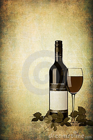 Bottle of red wine with glass on grunge textured