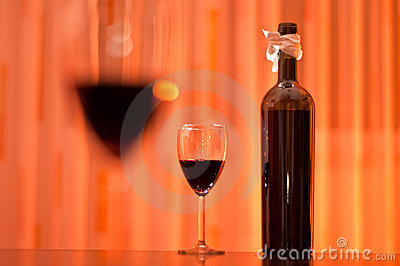 Bottle of red wine and glasses