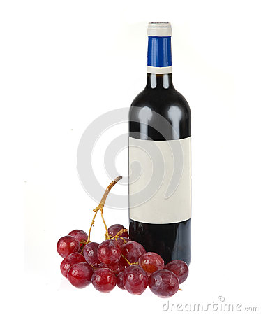 Bottle of red wine with grapes isolated