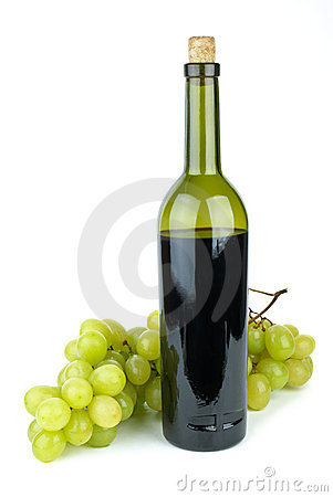 Bottle with red wine and green