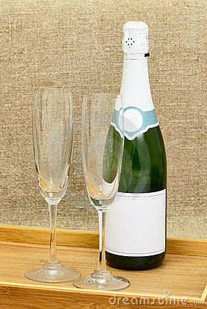 Bottle of sparkling wine and two wine glasses