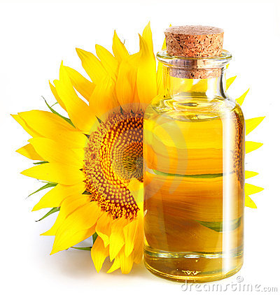 Bottle of sunflower oil with flower.