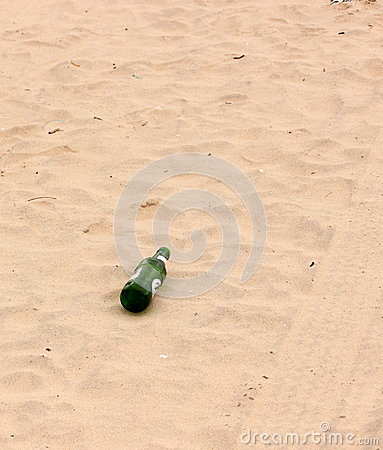 Bottle, tyre tracks in sand