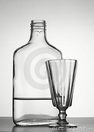 Bottle with vodka and liquor-glass
