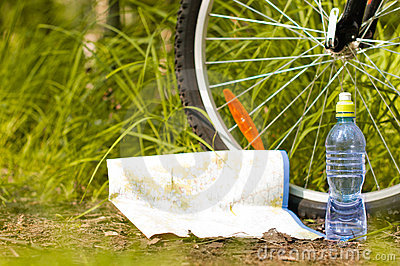 Bottle of water and near bicycle wheel