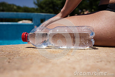Bottle of water on poolside