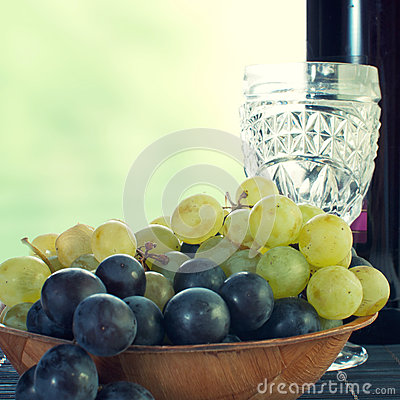 Bottle of wine with grape