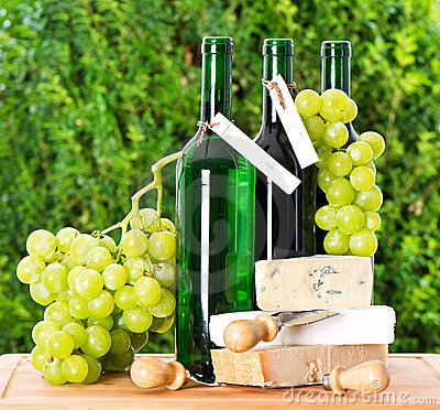 Bottle of wine, grape and cheese