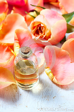 Free Bottle With Essential Aroma Oil On White Wooden Background. Royalty Free Stock Photography - 78727027