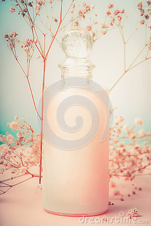 Free Bottle With Lotion Or Body Care Cream With Flowers , Natural Cosmetic Product Or Beauty Concept On Pastel Background Royalty Free Stock Photo - 95759415