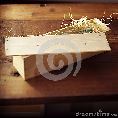 Bottle in a wooden box