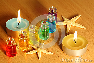 Bottles with aroma oils, candles and starfish