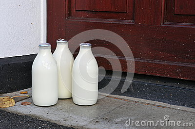 Bottles of Milk on a Doorstep