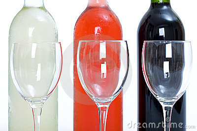 Bottles of red, white and rose wine with glasses