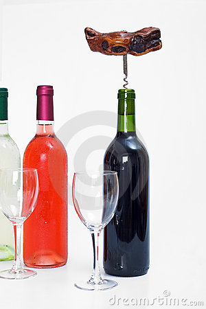 Bottles of red, white and rose wine with glasses and a corkscrew