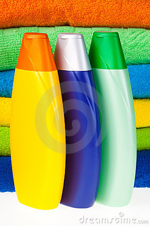 Bottles of shampoo and colour terry towels