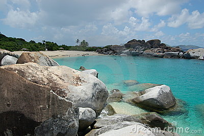 Boulders, beach and azure waters