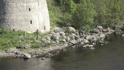 Boundary post of the Russian Federation on the river bank at fortress Ivangorod.  stock video