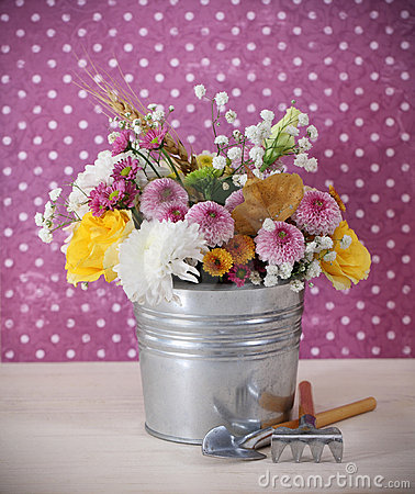 Bouquet of autumn flowers in the iron pot