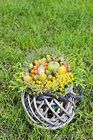 Bouquet of autumn plants in wicker basket