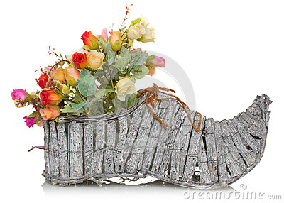 Bouquet of flower in wooden boot on a white background