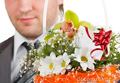 Bouquet of flowers against happy groom
