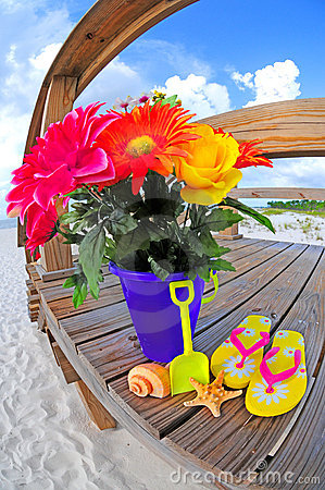 Bouquet of flowers by beach