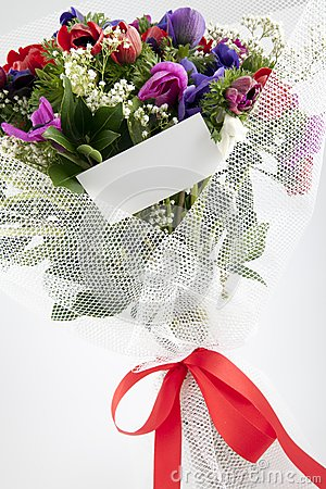 Bouquet of flowers with blank white card
