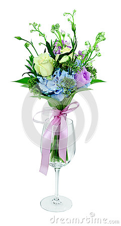 Bouquet of flowers in a glass on a white background